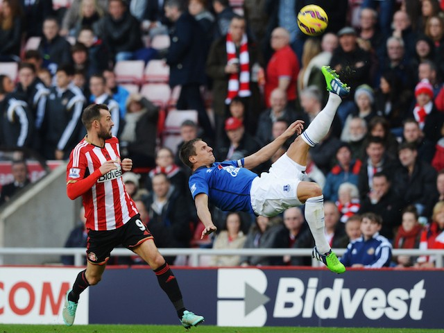 Phil Jagielka of Everton makes a spectacular clearance from Steven Fletcher of Sunderland during the Barclays Premier League match on November 9, 2014