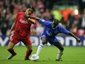 Milan Baros of Liverpool battles with Claude Makelele of Chelsea during the UEFA Champions League semi-final second leg match between Liverpool and Chelsea at Anfield on May 3, 2005