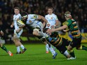Stephen Myler of Northampton Saints tackles Don Armand of Exeter Chiefs during the Aviva Premiership match between Northampton Saints and Exeter Chiefs at Franklin's Gardens on November 14, 2014