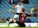 Alex Mowatt of Leeds United has his shot saved by Keiren Westwood of Sheffield Wednesday during the Sky Bet Championship match between Leeds United and Sheffield Wednesday at Elland Road on October 4, 2014