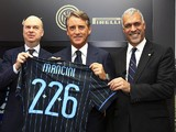 Marco Fassone, new coach of FC Internazionale Milano Roberto Mancini and Michael Bolingbroke during a press conference on November 15, 2014