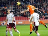 Dutch player Robin Van Persie (C) jumps to score a goal during the Euro 2016 qualifying round football match between Netherlands and Latvia at the Arena Stadium, on November 16, 2014