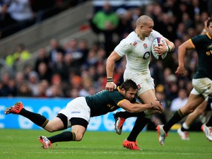 Mike Brown of England is tackled by Cobus Reinach of South Africa during the QBE Intenational match on November 15, 2014