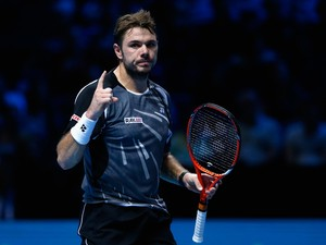 Stan Wawrinka of Switzerland celerates defeating Tomas Berdych of Czech Republic in the round robin during day two of the Barclays ATP World Tour Finals tennis at the O2 Arena on November 10, 2014