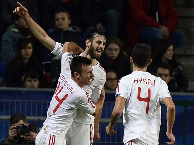 Albania's defender Mergim Mavraj is congratuled by teammates after scoring a goal during during the friendly football match France vs Albania on November 14, 2014