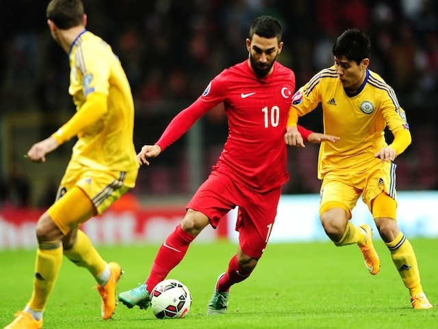 Turkey's Arda Turan (C) vies for the ball with Kazakhstan's Dmitri Shomko (R) and Bauyrzhan Tagybergen (L) during the UEFA Euro 2016 qualifying football match on November 16, 2014