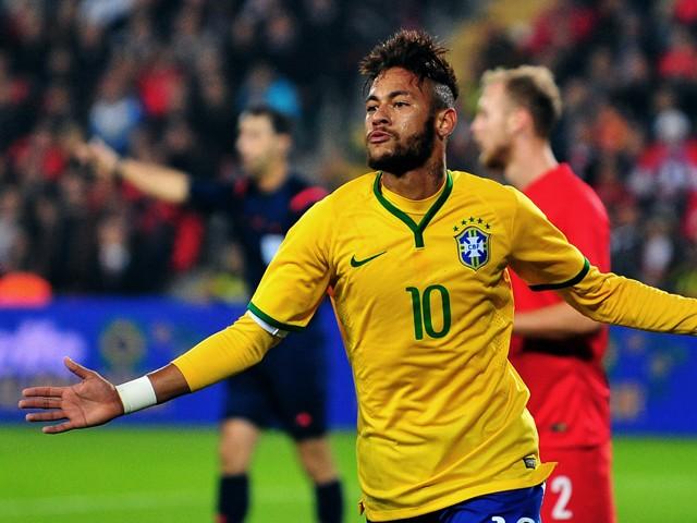 Brazil's forward Neymar celebrates after scoring a goal during a friendly football between Turkey and Brazil on November 12, 2014