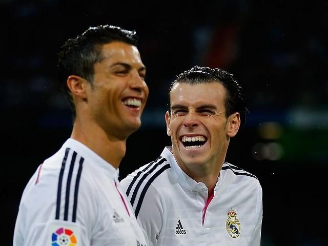 Cristiano Ronaldo (L) of Real Madrid jokes with his teammate Gareth Bale prior to start the La Liga match against Rayo Vallecano on November 8, 2014
