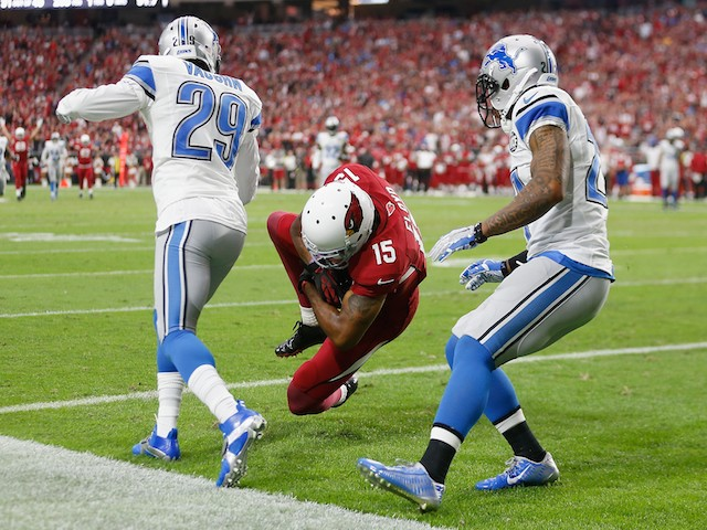 Wide receiver Michael Floyd #15 of the Arizona Cardinals catches the football to make 42 yard touchdown during first quarter of the NFL game against the Detroit Lions on November 16, 2014