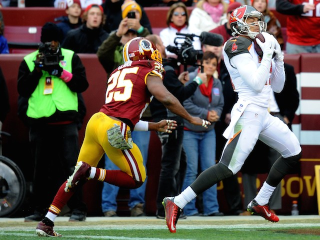 Wide receiver Mike Evans of the Tampa Bay Buccaneers makes a 3rd quarter touchdown catch over the free safety Ryan Clark of the Washington Redskins on November 16, 2014