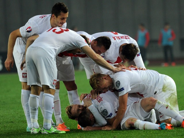 Poland's players celebrate after scoring during the UEFA Euro 2016 qualifying Group D football match Georgia vs Poland in Tbilisi on November 14, 2014
