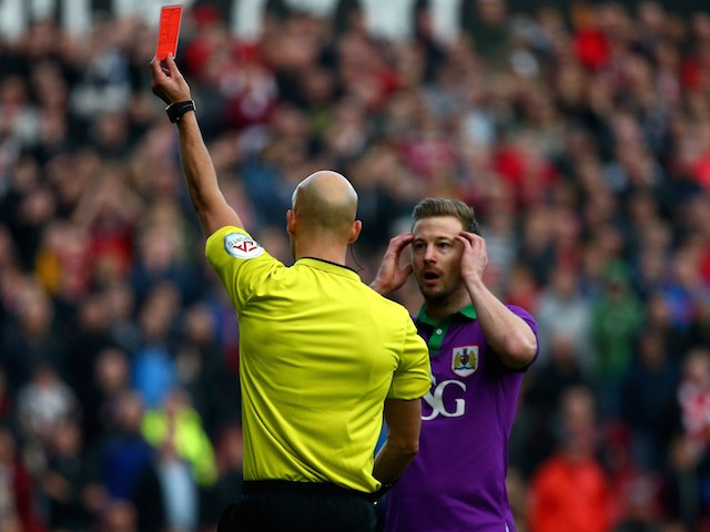 Wade Elliott of Bristol City reacts as is sent off by referee Darren Drysdale during the Sky Bet League One match against Swindon Town on November 15, 2014