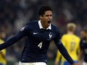 French defender Raphael Varane celebrates scoring a goal during the friendly football match France vs Sweden on November 18, 2014
