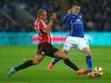 Wes Brown of Sunderland tackles Jamie Vardy of Leicester City during the Barclays Premier League match between Leicester City and Sunderland at The King Power Stadium on November 22, 2014