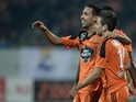 Lorient's French Portuguese defender Raphael Guerreiro celebrates with Lorient's French Algerian midfielder Walid Mesloub during the French L1 football match between Lorient and Lens at the Moustoir stadium in Lorient, western France, on November 22, 2014