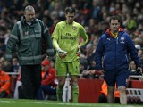 Arsenal's Polish goalkeeper Wojciech Szczesny has to leave the game after being injured in the incident leading to the opening goal in the English Premier League football match between Arsenal and Manchester United at the Emirates Stadium in London on Nov