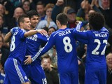 Diego Costa of Chelsea celebrates scoring opening goal with team mates during the Barclays Premier League match between Chelsea and West Bromwich Albion at Stamford Bridge on November 22, 2014