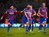 Mile Jedinak of Crystal Palace celebrates scoring his team's third goal with team mates during the Barclays Premier League match between Crystal Palace and Liverpool at Selhurst Park on November 23, 2014