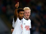 Jordan Ibe of Derby County celebrates with Will Hughes after scoring the opening goal during the Sky Bet Championship match between Watford and Derby County at Vicarage Road on November 22, 2014