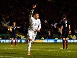 Alex Oxlade-Chamberlain of England celebrates after scoring the opening goal during the International Friendly match between Scotland and England at Celtic Park Stadium on November 18, 2014
