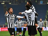 Juventus' midfielder from France Paul Pogba is congratulated by Juventus' midfielder Claudio Marchisio and Juventus' forward from Argentina Carlos Tevez during the Ita