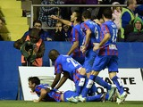 Levante's players celebrate after scoring during the Spanish league football match Levante UD vs Valencia CF at the Ciutat de Valencia stadium in Valencia on November 23, 2014.