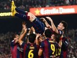 Lionel Messi of FC Barcelona celebrates with his teammates after scoring his team's fourth goal during the La Liga match against Sevilla FC at Camp Nou on November 22, 2014