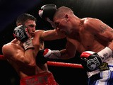 Nathan Cleverly (L) of Wales and Tony Bellew of England exchange punches during the WBO Light-Heavyweight Championship of the World bout on October 15, 2011