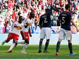 Bradley Wright-Phillips #99 of New York Red Bulls celebrates a first half goal with Lloyd Sam #10 against the New England Revolution during the Eastern Conference Final - Leg 1 at Red Bull Arena on November 23, 2014