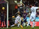 Real Madrid's Colombian forward James Rodriguez heads the ball to score past Eibar's goalkeeper Irureta during the Spanish league football match SD Eibar vs Real Madrid CF at the Ipurua stadium in Eibar on November 22, 2014