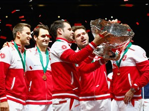 Roger Federer of Switzerland, Stanislas Wawrinka of Switzerland , Marco Chiudinelli of Switzerland, Michael Lammer of Switzerland and Captain Severin Luthi of Switzerland celebrate winning the Davis Cup against France during day three of the Davis Cup Ten