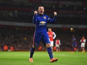 Manchester United's Wayne Rooney celebrates after Arsenal's own goal on November 22, 2014