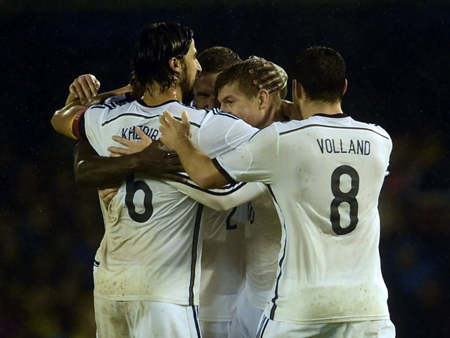 Germany's midfielder Toni Kroos celebrates with his teammates after scoring during a friendly football match Spain vs Germany at the Balaidos stadium in Vigo on November 18, 2014