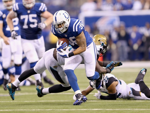 Daniel Herron #36 of the Indianapolis Colts runs with the ball during the game against the Jacksonville Jaguars at Lucas Oil Stadium on November 23, 2014
