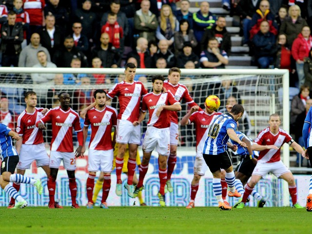 Shaun Maloney of Wigan Athletic scores the first goal during the Sky Bet Championship match between Wigan Athletic and Middlesbrough at DW Stadium on November 22, 2014