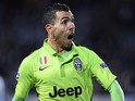 Juventus' forward Carlos Tevez celebrates after scoring a goal during the UEFA Champions League group A football match Malmo FF vs Juventus at the Swedbank Stadion in Malmo, Sweden on November 26, 2014