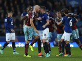 James Collins of West Ham United confronts James McCarthy of Everton during the Barclays Premier League match