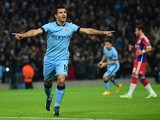 Manchester City's Argentinian striker Sergio Aguero celebrates scoring the opening goal from a penalty kick during the UEFA Champions League Group E football match between Manchester City and Bayern Munich at the Etihad Stadium in Manchester, northwest En