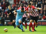 Sergio Aguero of Manchester City holds off Jose Fonte of Southampton during the Barclays Premier League match between Southampton and Manchester City at St Mary's Stadium on November 30, 2014