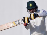 Pakistani batsman Mohammad Hafeez plays a shot during the first day of the third and final Test match between Pakistan and New Zealand at the Sharjah cricket stadium in Sharjah on November 26, 2014