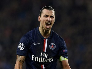 Paris Saint-Germain's Swedish forward Zlatan Ibrahimovic reacts after scoring a goal during the UEFA Champions League group F football match between Paris Saint-Germain and Ajax Amsterdam on November 25, 2014