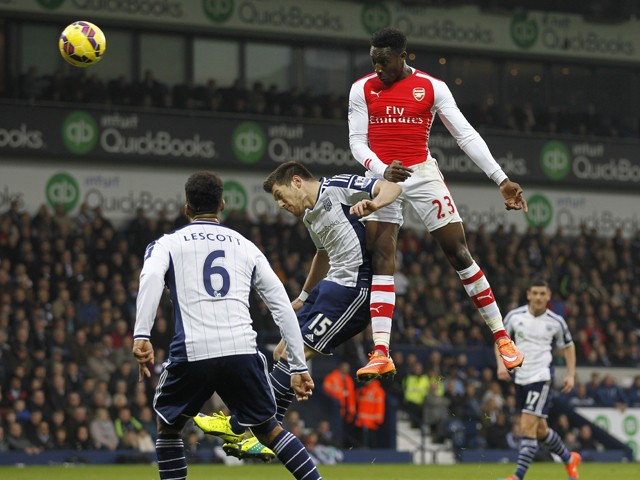 Arsenal's English striker Danny Welbeck jumps to head the opening goal of the English Premier League football match between West Bromwich Albion and Arsenal at The Hawthorns in West Bromwich Albion and Arsenal at The Hawthorns on November 29, 2014