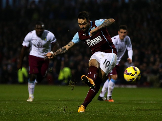 Danny Ings of Burnley scores his team's first goal from the penalty spot during the Barclays Premier League match between Burnley and Aston Villa at Turf Moor on November 29, 2014