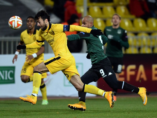Lille's Marko Basa and Krasnodar's Ari fight for the ball during a UEFA Europa League football match FC Krasnodar vs. LOSC Lille in Krasnodar on November 27, 2014