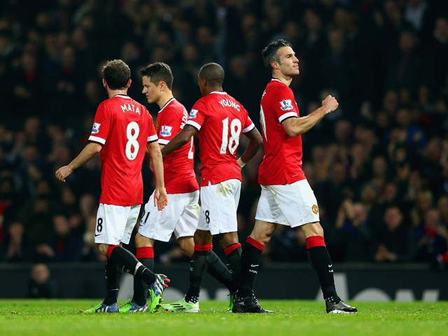 Robin van Persie of Manchester United (R) celebrates scoring their third goal during the Barclays Premier League match between Manchester United and Hull City at Old Trafford on November 29, 2014