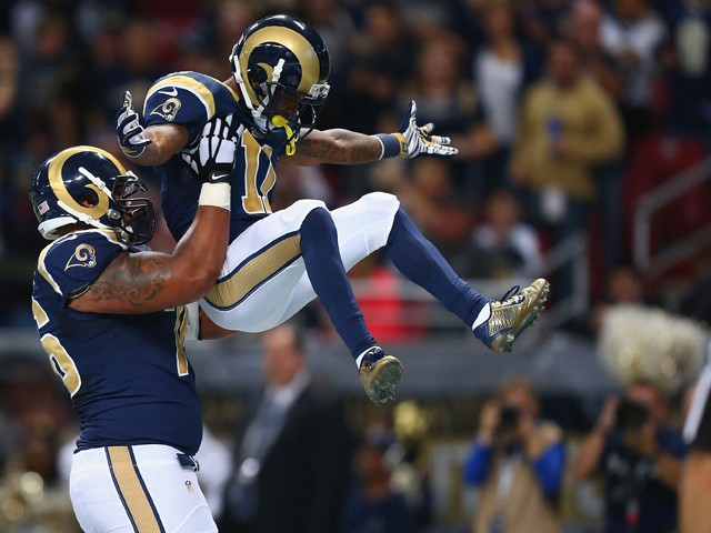 Rodger Saffold #76 and Tavon Austin #11 of the St. Louis Rams celebrate Austin's first quarter touchdown against the Oakland Raiders at the Edward Jones Dome on November 30, 2014