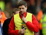 Steven Gerrard of Liverpool walks to the bench before the Barclays Premier League match between Liverpool and Sunderland at Anfield on December 6, 2014