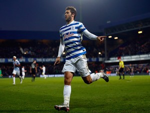Charlie Austin of QPR celebrates scoring his team's second goal during the Barclays Premier League match against Burnley on December 6, 2014