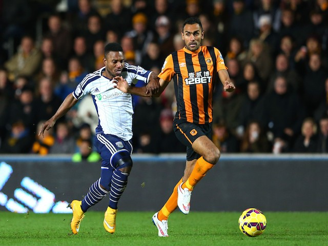 Ahmed Elmohamady of Hull City is challenged by Stephane Sessegnon of West Brom during the Barclays Premier League match on December 6, 2014