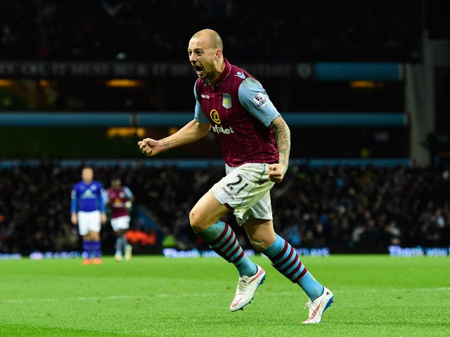 Alan Hutton of Villa celebrates after scoring the second goal during the Barclays Premier League match between Aston Villa and Leicester City at Villa Park on December 7, 2014